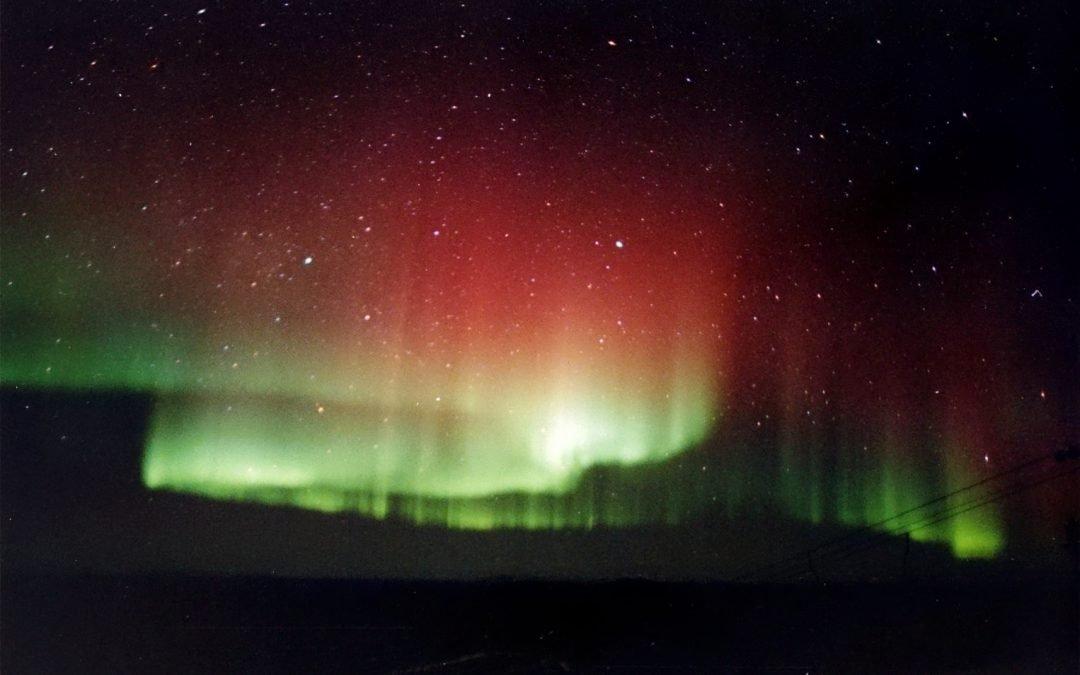Red white and green Aurora Borealis