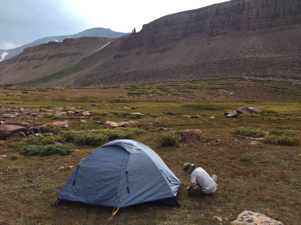 Boy setting up tent