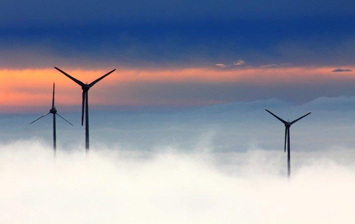 3 wind turbines on a misty day